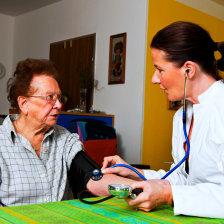 nurse checking the senior woman's health