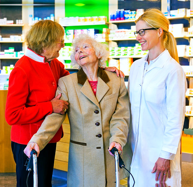 pharmacist talking to senior women
