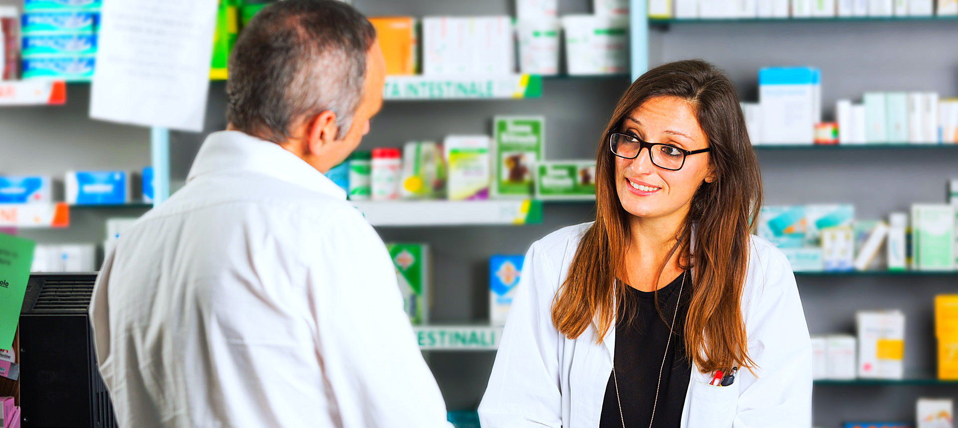 two pharmacists talking to each other