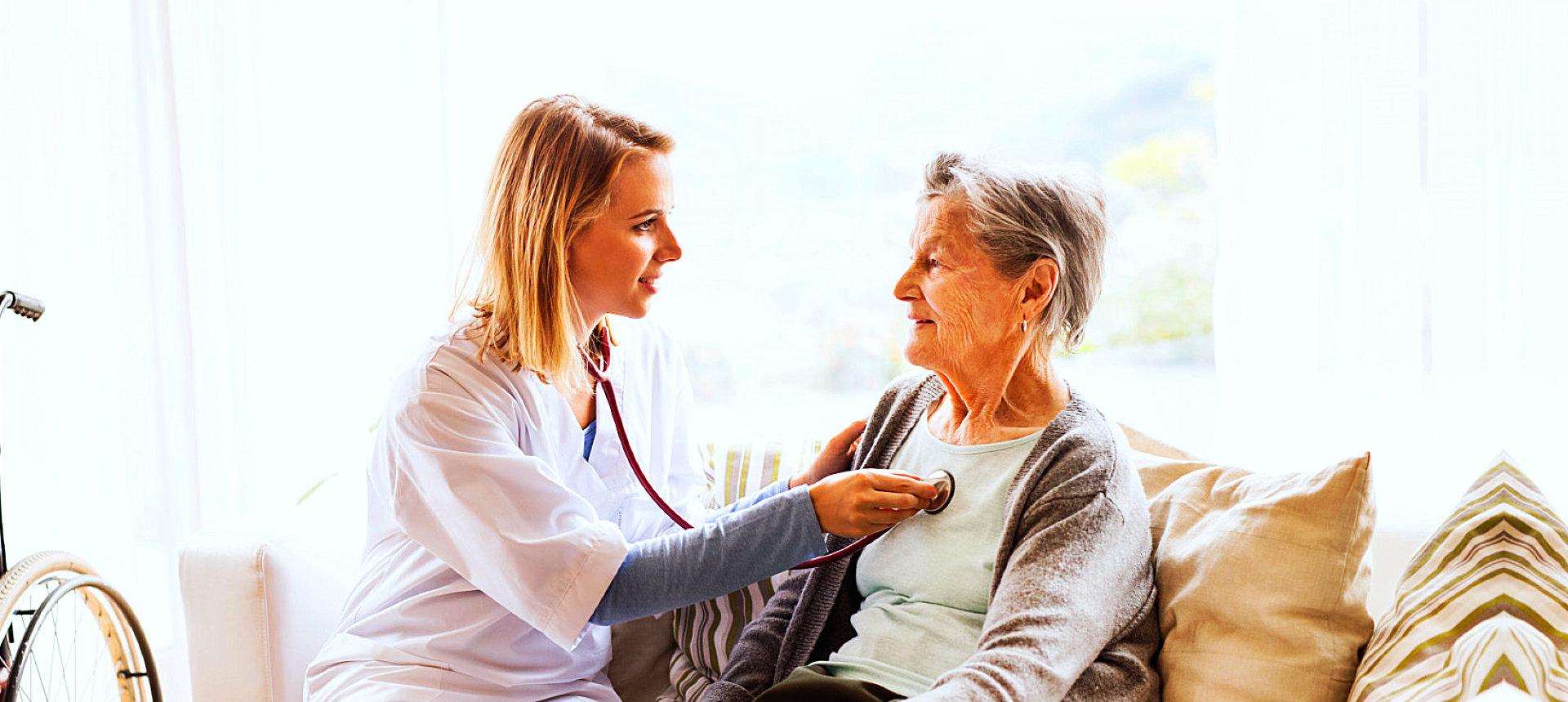 pharmacist checking senior woman's health