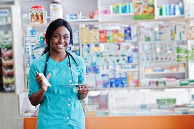 female pharmacist working in drugstore at hospital pharmacy